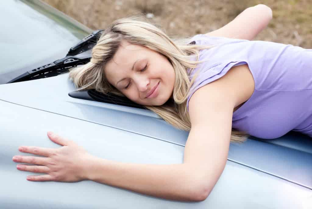 woman-hugging-brand-new-car